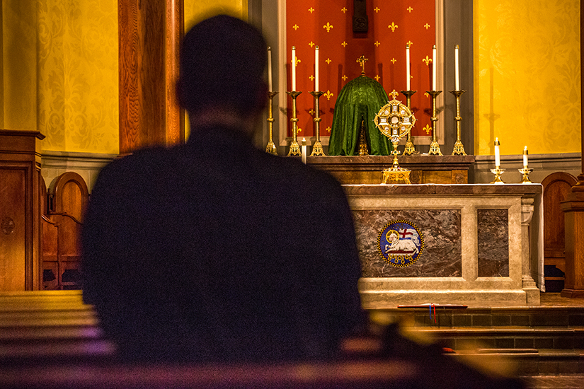 Michael Trummer, a Theology III student from Springfield, Ill.., prayed in the chapel at Kenrick-Glennon Seminary during eucharistic adoration on Sept. 10.