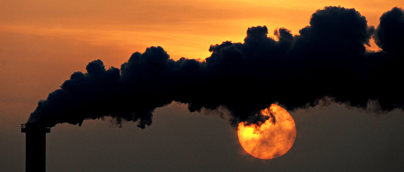 Smoke billows from a plant in 2015 at sunset in Wismar, Germany.