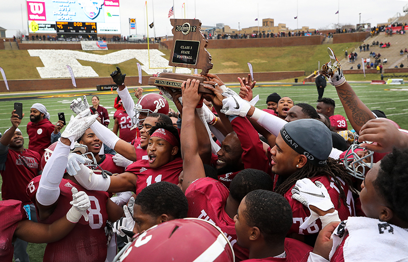 Trinity Catholic High School players celebrated their state title Dec. 1. Trinity defeated Cardinal Ritter Preparatory High 45-19 in the Missouri State High School Activities Association Class 3 football championship game at Faurot Field in Columbia, Mo.