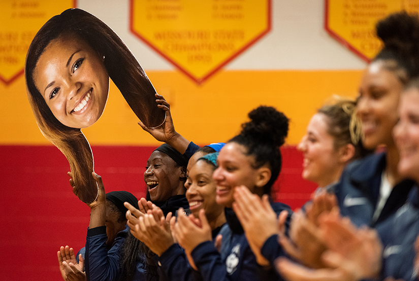 A giant cutout of Incarnate Word Academy alumna Napheesa Collier was waved by one of her current teammates from the University of Connecticut at a ceremony honoring the Incarnate Word basketball team, coaches and players. Collier's number was retired and fans, alumnae and players celebrated the program being named to the Missouri Sports Hall of Fame earlier this year. The UConn team was in St. Louis to play Saint Louis University Dec. 4.