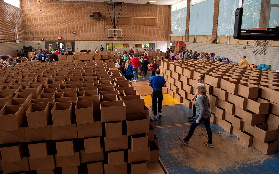 Empty cardboard boxes awaited filling by volunteers with items for Christmas baskets being distributed to people helped by Father Bob's Outreach. The ministry assists people in need in north St. Louis, primarily in the areas served by St. Augustine and St. Elizabeth Mother of John the Baptist parishes. During the Dec. 1 work day, the group packed 3,000 Christmas baskets with non-perishable items.
