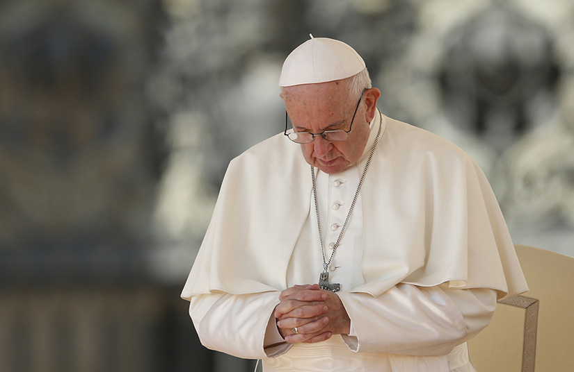 Pope Francis prayed in St. Peter's Square at the Vatican in October. At his weekly audience Dec. 5, the pope said that Jesus, who often felt the need to withdraw into solitude and pray, wants to introduce us to His intimacy with the Father.