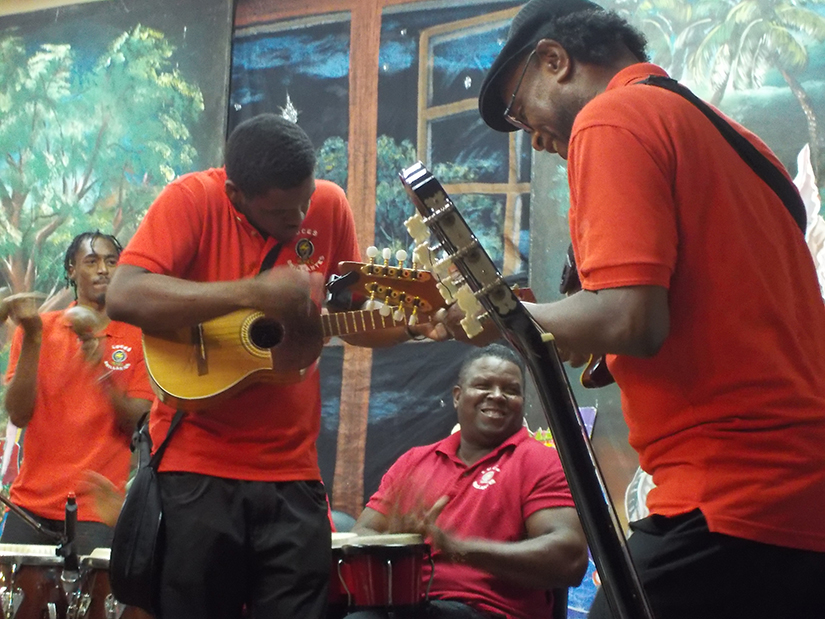 Julio Torres, veteran parang musician and vocal coach who mentors young men, right, performed during the Luces Brilliantes fundraiser performance Nov. 18 at St. Theresa Parish in Barataria, Trinidad and Tobago.