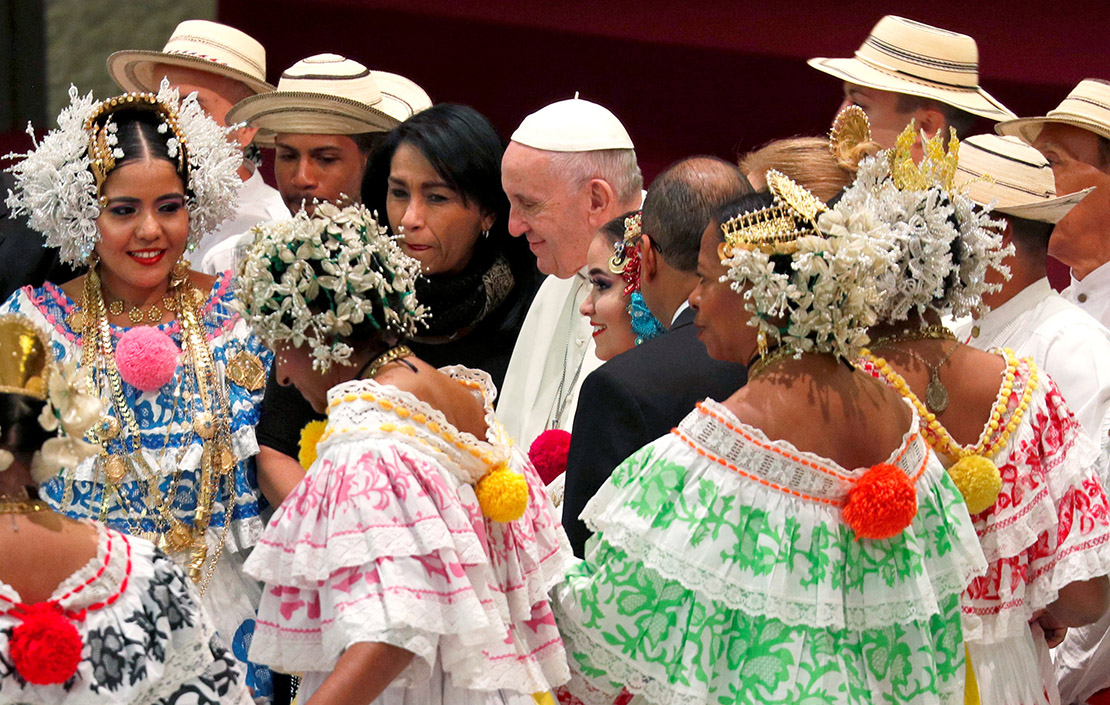 Pope Francis walked past people in traditional clothing at his general audience in Paul VI Hall Dec. 12. Before the audience, the pope blew out candles on a cake a visitor had prepared. The pope will celebrate his 82nd birthday Dec. 17.