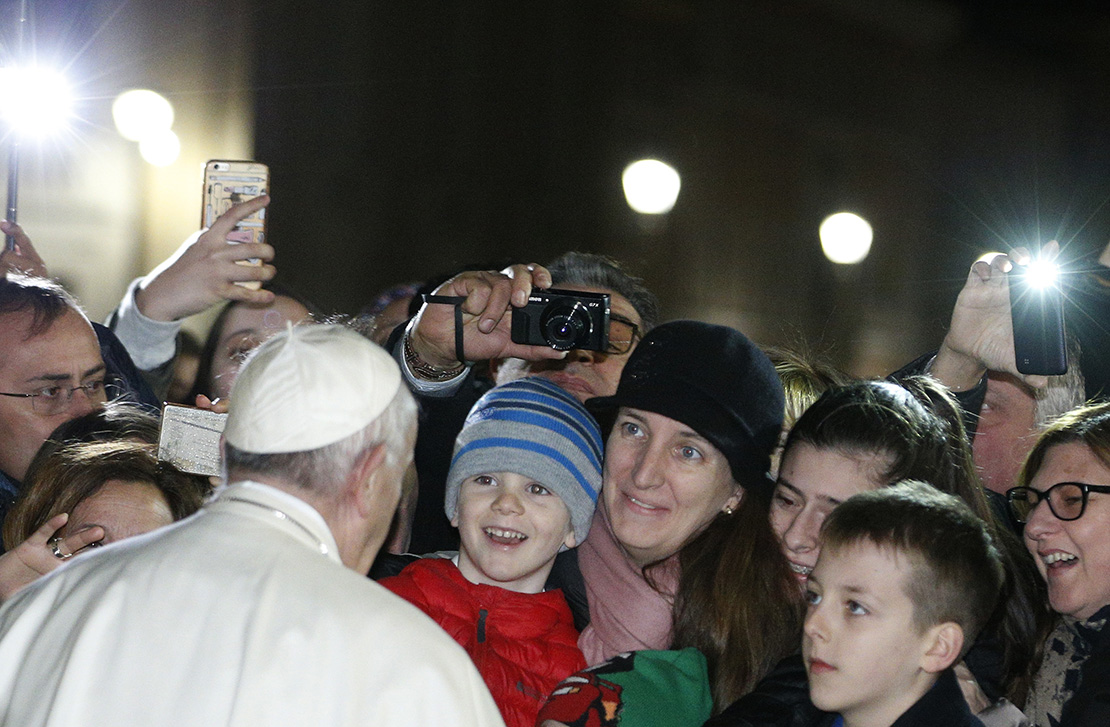 Pope Francis greeted people after visiting the Nativity scene in St. Peter's Square Dec. 31.