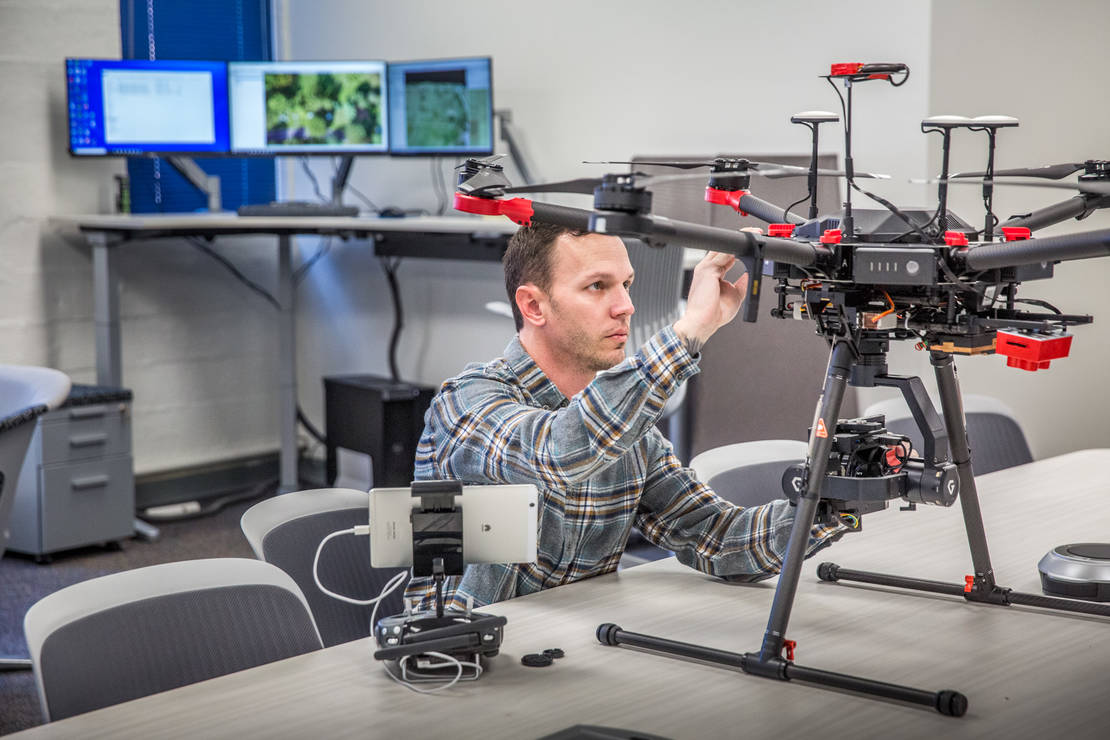 Doctoral student Sean Hartling worked on calibrating an infrared heat sensing camera on a drone used for atmospheric research at the Remote Sensing Lab on the Saint Louis University campus on Jan 8, 2019.Vasit Sagan, Ph.D. runs the Department of Earth & Atmospheric Sciences at Saint Louis University where their remote sensing lab employs high tech imaging systems paired with drones to collect and analyze data for atmospheric study.