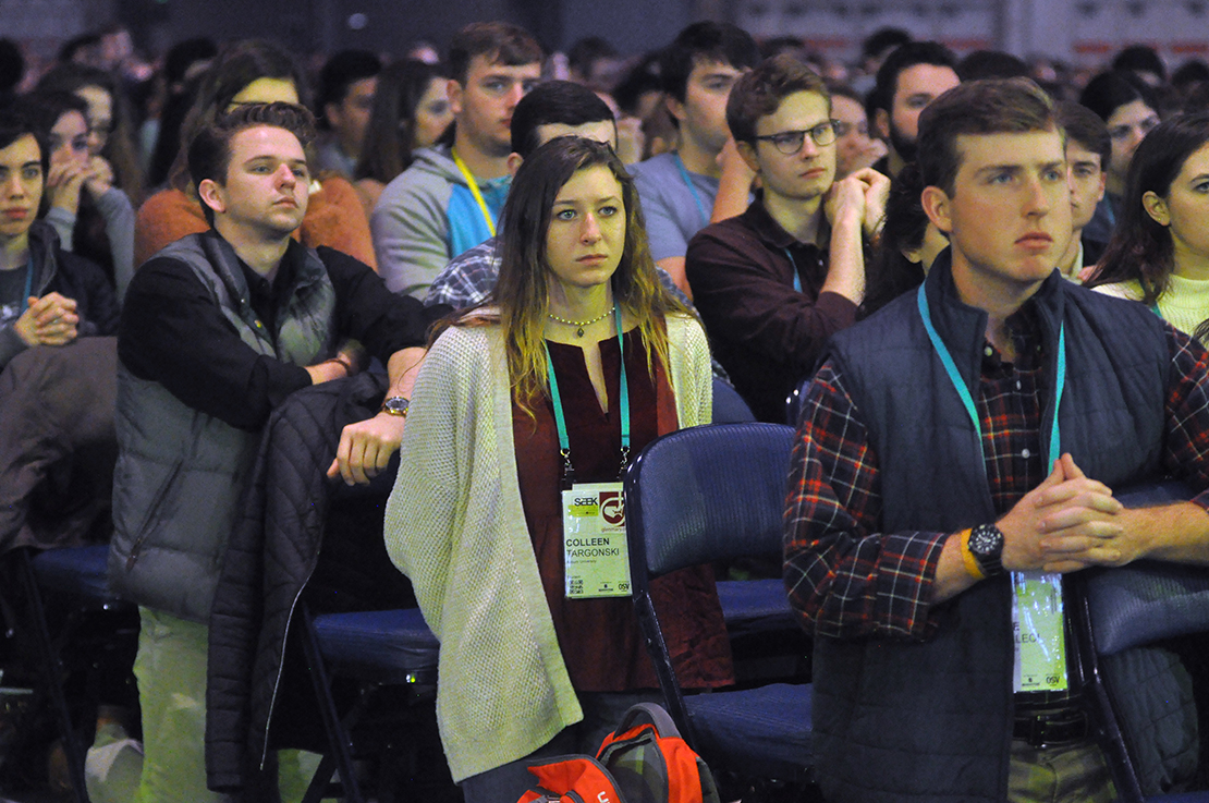 Young people knelt in prayer Jan. 6 at Mass at the SEEK conference that drew 17,000 mainly college students from across the country to the Indiana Convention Center in Indianapolis. The conference is a biennial event sponsored by the Fellowship of Catholic University Students.