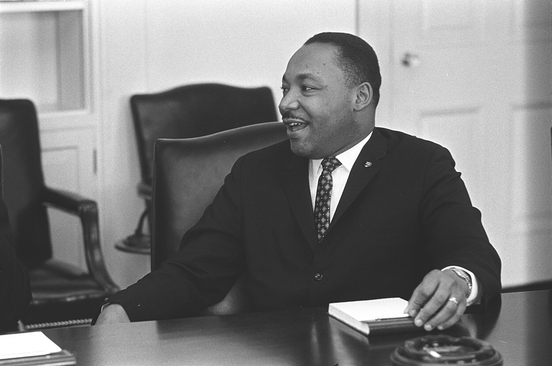 Civil rights leader the Rev. Martin Luther King Jr. smiled during a talk with U.S. President Lyndon B. Johnson, not pictured, in this undated photo.