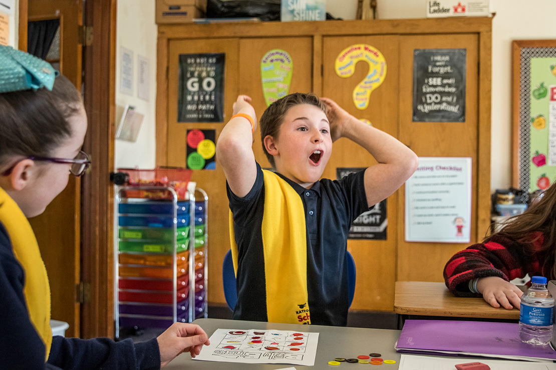 "Beau Riddle reacted to winning the final round of ""body bingo"" in Breanna Juliette's fourth-grade class at St. Joachim School on Jan. 24. The game helped the students to memorize parts of the human body."