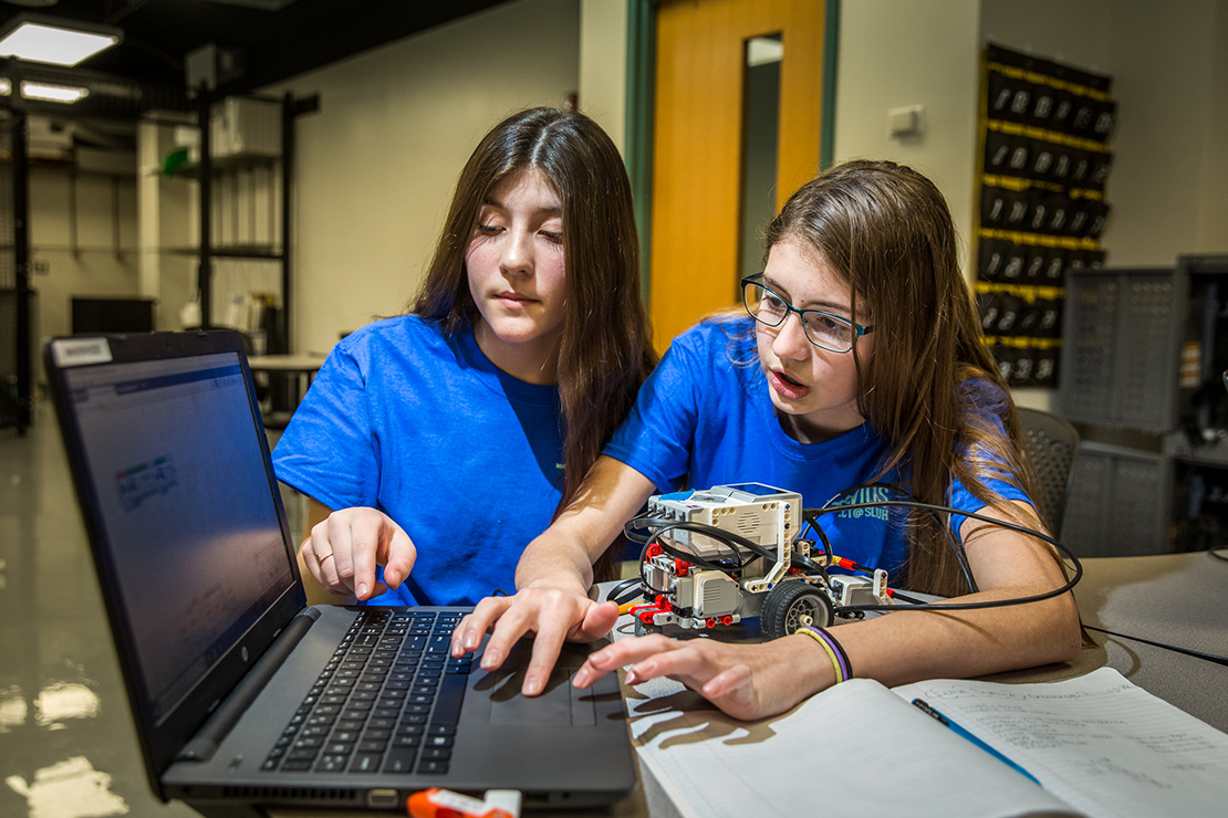 Gianna Schurk, left, and Isabella Johnston programmed their robot named CALI (Cool, Amazing, Lego Intelligent) Jan 29 at St. Joseph School in Imperial. With help from the Clavius Project at SLUH, the school started robotics last year.