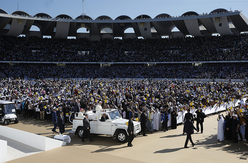Pope Francis greeted the crowd as he arrived to celebrate Mass at Zayed Sports City Stadium in Abu Dhabi, United Arab Emirates, Feb. 5.