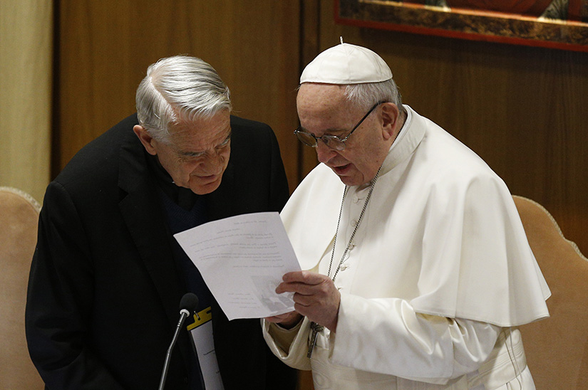Pope Francis talked with Father Federico Lombardi at the start of the third day of the meeting on the protection of minors in the church at the Vatican Feb. 23.
