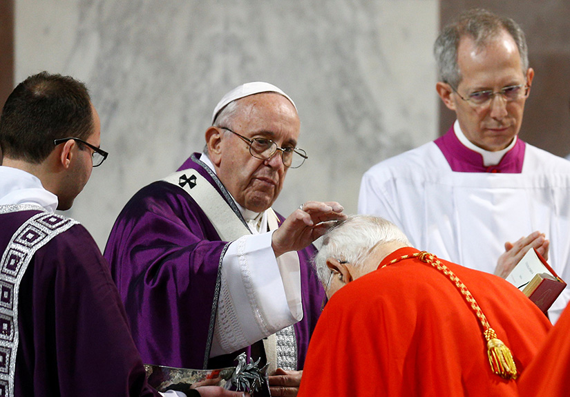 Pope Francis places ashes on the head of a cardinal during Ash Wednesday Mass at Santa Sabina Basilica in Rome March 6, 2019.