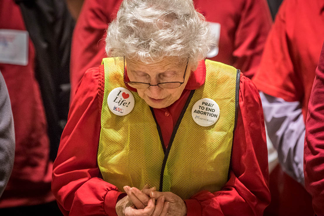 Sandie Colbert from Kansas City prayed during pro-life lobby day March 12 in Jefferson City. More than 300 people attended the lobby day.