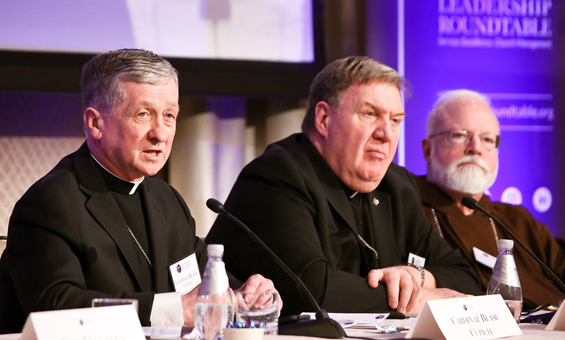 Chicago Cardinal Blase J. Cupich, left, spoke Feb. 1 at a panel discussion at the Leadership Roundtable's Catholic Partnership Summit in Washington to propose solutions to the Church's sex abuse crisis. He is joined at the table by Cardinal Joseph W. Tobin of Newark, N.J., center, and Boston Cardinal Sean P. O'Malley.