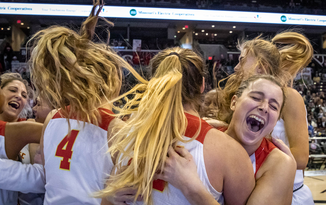 Samantha Eaker, right, embraced teammate Kiki Britzmann after Incarnate Word Academy won its 10th state basketball title March 16 in Springfield. Incarnate Word defeated Lincoln College Prep 61-35.