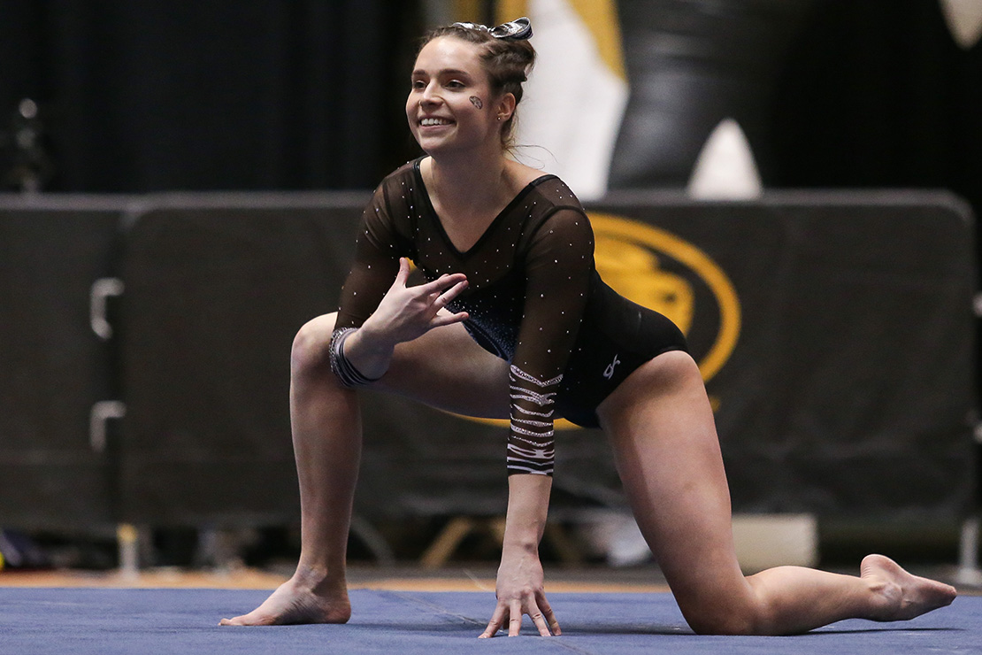 "University of Missouri gymnast Madeleine Huber competed in the floor exercise against the University of Alabama on Feb. 1. In her freshman year, Huber attended Ultimate Training Camp for college athletes. ""This was life-changing for me, a huge turning point in my faith journey,"" she said"