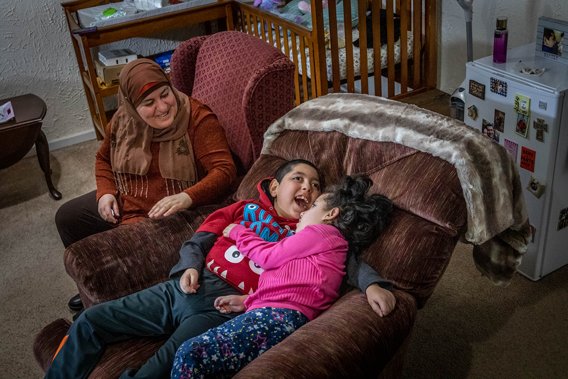 "Kifah Abdallah watched as Nabeel and his sister Carole rocked on a chair together. ""He is very protective of her,"" she said. Through a connection with St. Rose Philippine Duchesne Church in Florissant and SSM Cardinal Glennon Children's Hospital, Nabeel's parents, Tariq Alkfoof and his wife Hibah Alkufouf, were able to come to St. Louis from Jordan for better medical care for their children."