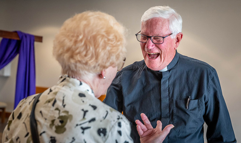 "Father Gerald Meier, who is retired and in residence at Holy Spirit Parish in Maryland Heights, talked with Miriam Woodruff before Mass. ""He is so funny and personable, but when he is on the altar, he is a holy man. We hope he says here for the rest of his life,"" she said."
