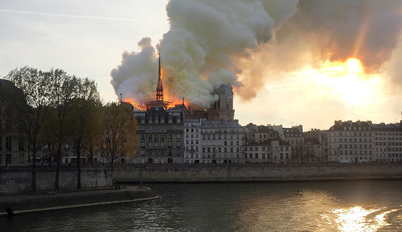 Flames and smoke billow from the Notre Dame Cathedral after a fire broke out in Paris April 15. Officials are unsure of the cause of the fire, but suggested it could be linked to renovation work.