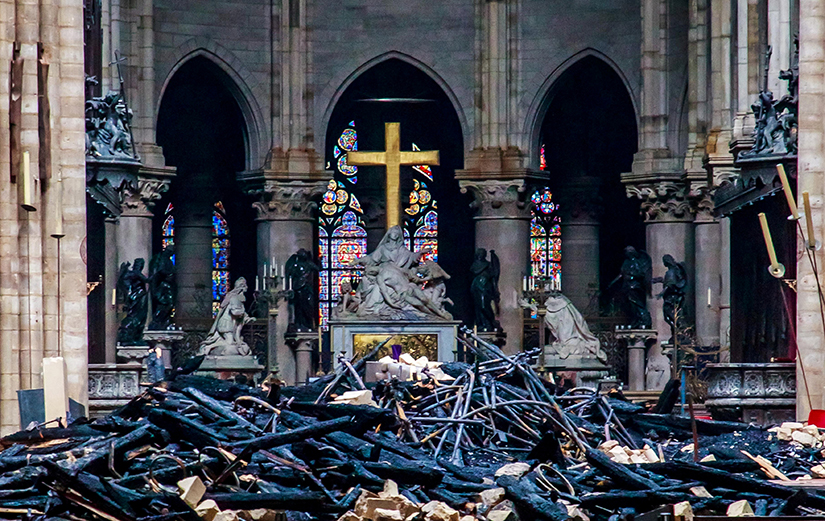 Debris surrounded a depiction of the Pieta by Nicolas Coustou in Notre Dame Cathedral April 16, a day after a major fire destroyed much of the church's wooden structure. Officials were investigating the cause, but suspected it was linked to renovation work.