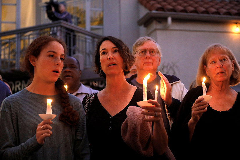 "People participated in a candlelight vigil April 27 at Rancho Bernardo Community Presbyterian Church for victims of a shooting incident at the Congregation Chabad synagogue in Poway, Calif., near San Diego. In response to the shooting, Cardinal Daniel N. DiNardo of Galveston-Houston and president of the U.S. Conference of Catholic Bishops, wrote in a statement April 28: ""Our country should be better than this; our world should be beyond such acts of hatred and anti-Semitism."""