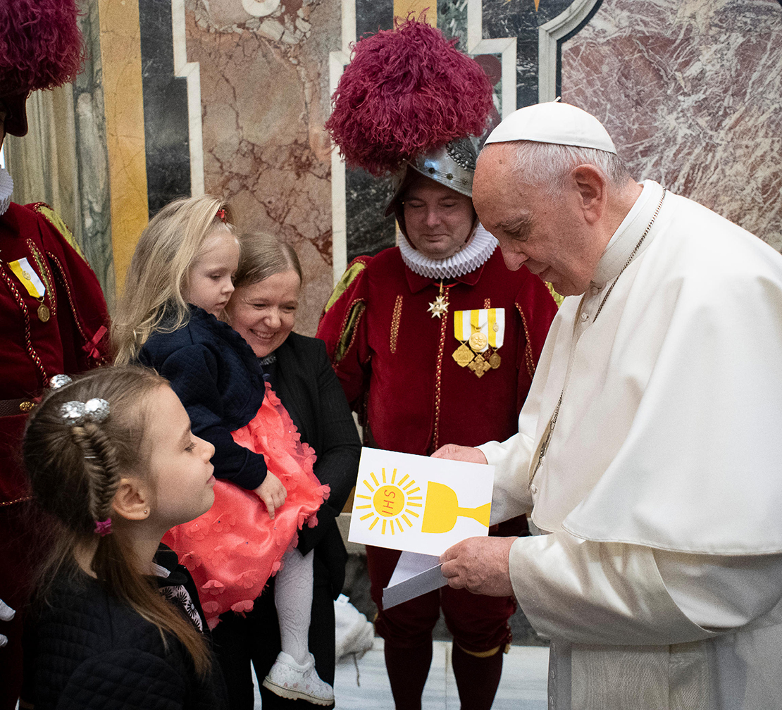 Pope Francis read a card from a child as he welcomed 23 new recruits to the Swiss Guard and family members May 4 at the Vatican. The pope encouraged the new recruits to be holy and a source of encouragement and inspiration to others during their service. The values they learn by living in barracks, such as understanding diversity, dialogue and loyalty will serve them well in life, he said.