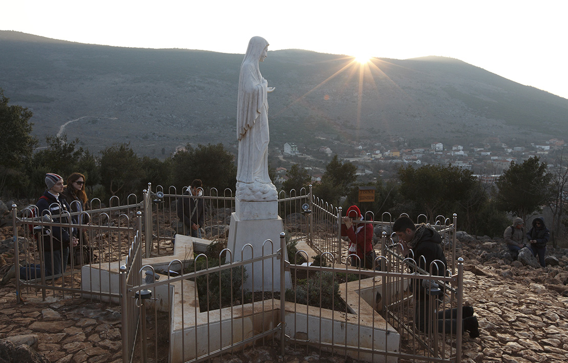 Pilgrims prayed near a statue of Mary on Apparition Hill in Medjugorje, Bosnia-Herzegovina, in 2011. Pope Francis has decided to allow parishes and dioceses to organize official pilgrimages to Medjugorje; no decision has been made on the authenticity of the apparitions.