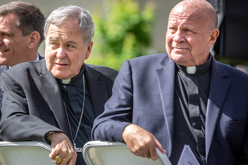 Archbishop Robert J. Carlson and president emeritus of St. Louis University, Father Lawrence Biondi, SJ, turned to look at the unveiled street sign along Grand Avenue showing the road was honorarily named after Father Biondi.