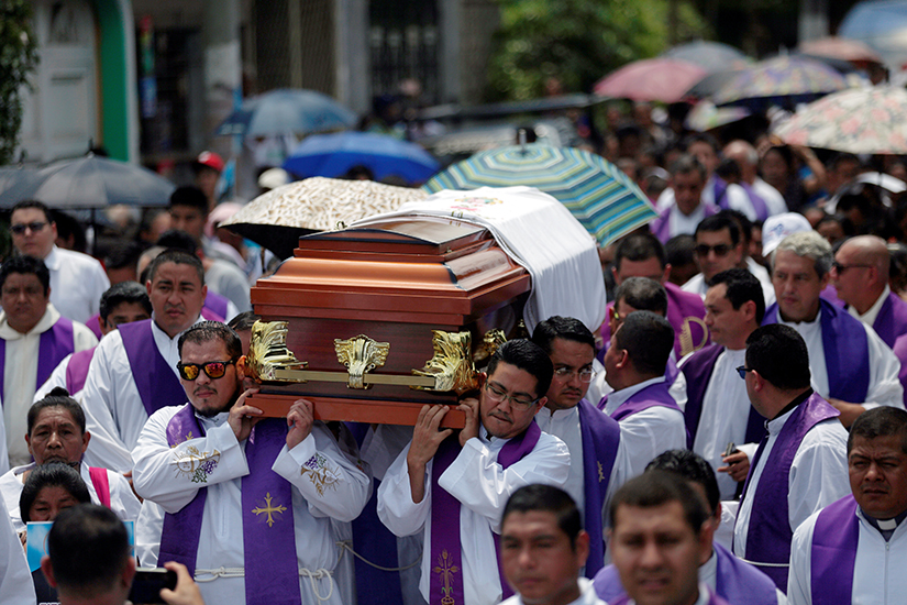 "Priests carried the casket of Father Cecilio Perez Cruz during his funeral procession in Sonzacate, El Salvador, May 20, 2019. Parishioners found Father Perez dead in his residence in Juayua early May 18 with a note nearby that said he had not paid ""rent,"" a euphemism for extortion money."