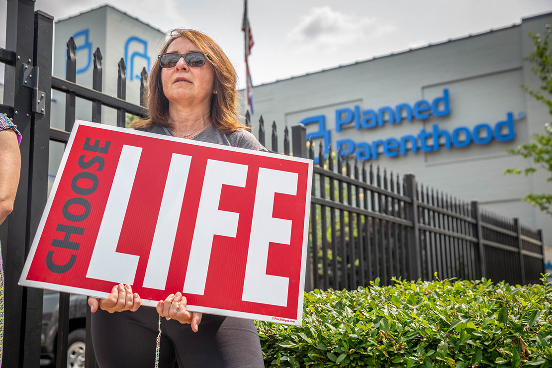 Donna Bambao, a parishioner from the Oratory of St. Francis de Sales, stood along the fence at Planned Parenthood in St. Louis May 31.