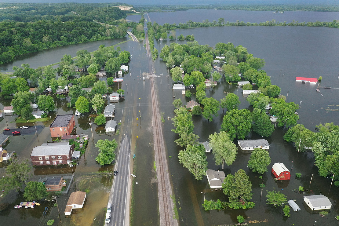 Floodwater from the Mississippi River inundate Foley in early June. St. Vincent de Paul conferences and Catholic Charities of St. Louis are working to assist flood victims.