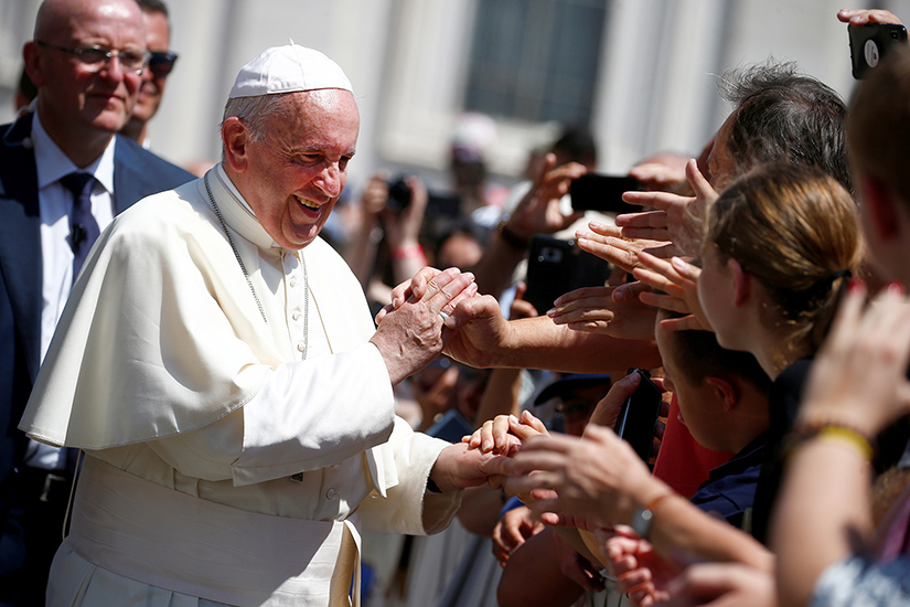 Pope Francis greeted pilgrims during his general audience in St. Peter's Square at the Vatican June 19.