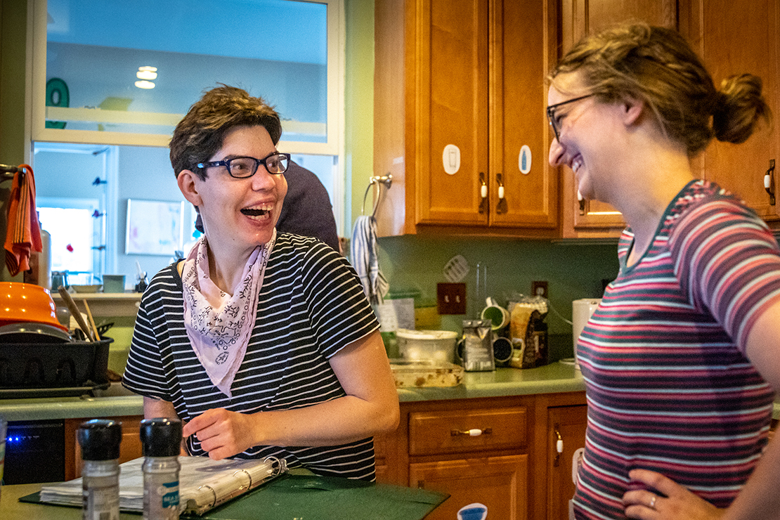 Kira Brandt, left, and Kristina Roselle worked in the kitchen at a L'Arche home in St. Louis July 1. L'Arch is a community in which adults with disabilities live with assistants and share share day-to-day activities, including meals and chores.
