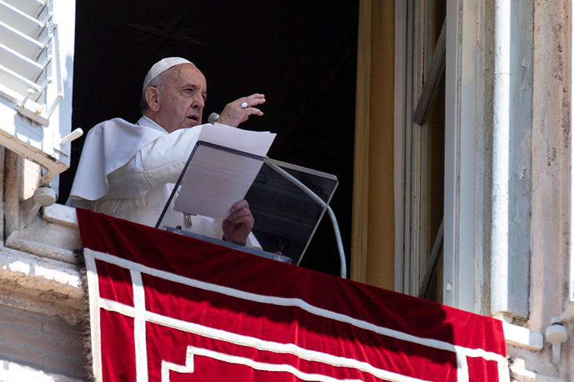 Pope Francis gave a blessing as he led the Angelus from the window of his studio overlooking St. Peter's Square June 30.