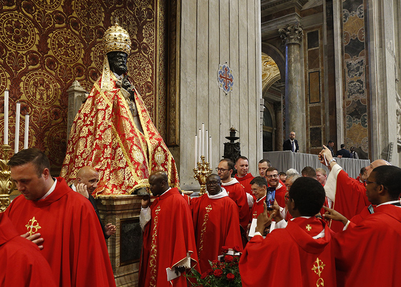 Clerics reverenced the statue of St. Peter after attending Pope Francis' celebration of Mass marking the feast of Sts. Peter and Paul in St. Peter's Basilica June 29. After the Mass, the pope presented palliums to new archbishops from around the world.