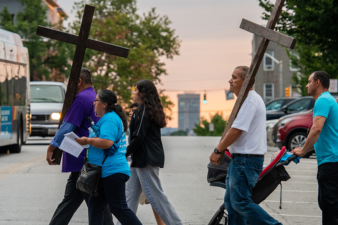 Particpants carried crosses in the refugee-themed Stations of the Cross in Baltimore July 23. More than 200 people participated in the event which included prayer for refugees and migrants and reflections at each station.