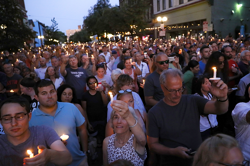 Mourners gathered Aug. 4 for a vigil at the scene of a mass shooting in Dayton, Ohio. Multiple people in Ohio were killed in the second mass shooting in the U.S. in less than 24 hours.