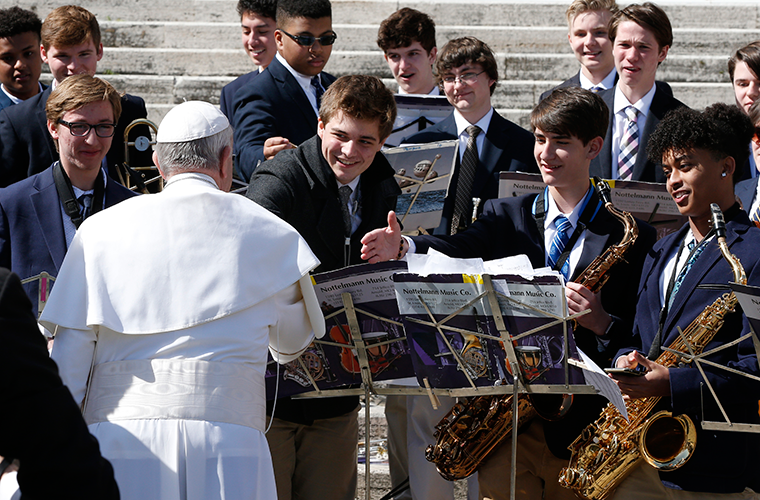 "Pope Francis spontaneously greeted student musicians from St. Louis University High School at his general audience March 14 in St. Peter's Square at the Vatican. From left to right, the SLUH students are: Sam Pottinger, senior; Emmanuel Parker, senior; Bobby Rizzo, freshman; Ezana Ephrem, senior. The pope listened to the band play ""Oh Sacred Head Now Wounded."" Some SLUH students were in Rome for spring break a part of the school's bicentennial celebration."