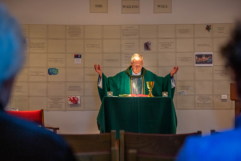 Msgr. Jack Schuler celebrated Mass Aug. 17 in the chapel at St. Cronan Parish in St. Louis. The parish created a wailing wall behind the altar with written prayers and reflections on the issue of clergy sexual abuse.