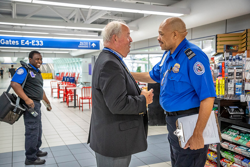 Deacon James Martin talked with Carolyn Cunningham as he walked his rounds as chaplain at St. Louis Lambert International Airport Aug. 26. Deacon Martin is one of several permanent deacons who serve in the archdiocesan Airport Chaplaincy's ministry of presence. Chaplains take shifts checking on and responding to travelers and employees in need of comfort or spiritual uplift.