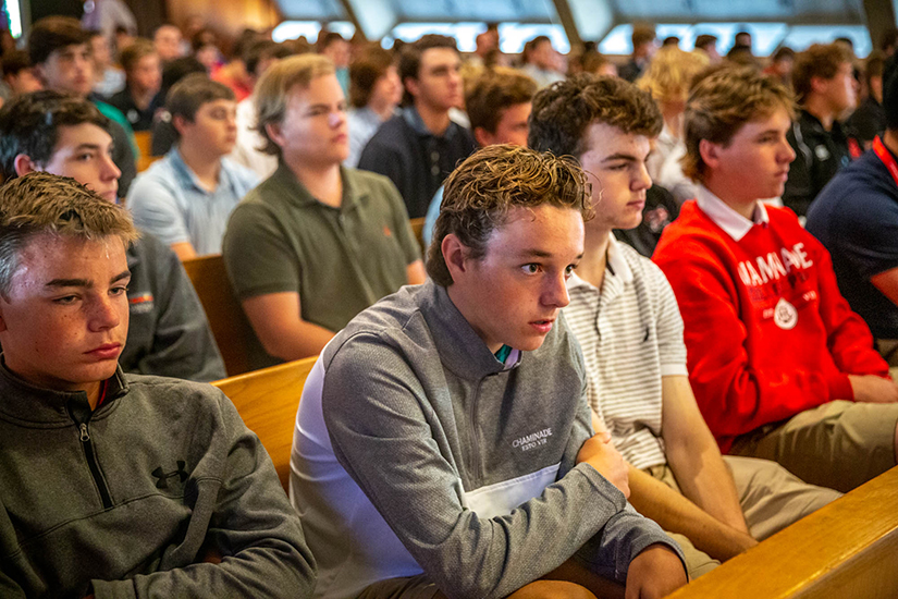 Sophomore Conner Fulton sat with other members of the Maucerc House in the chapel at Chaminade College Preparatory High School in Creve Coeur.