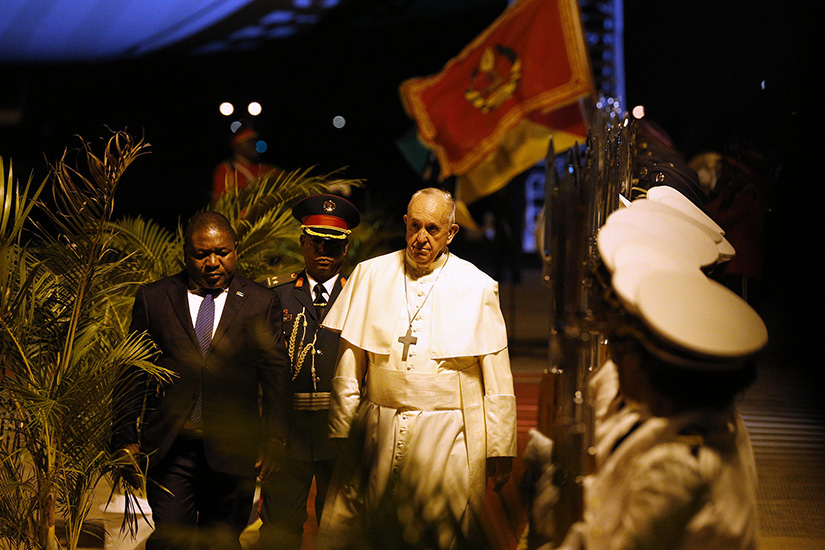 Pope Francis walked with President Filipe Nyusi of Mozambique at Maputo International Airport Sept. 4, after the pope's arrival for a weeklong visit to Mozambique, Madagascar and Mauritius.