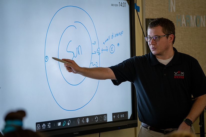 Michael Plas, a science teacher at St. Agnes School in Louisville, Ky., taught a lesson to sixth-graders Aug. 21. The school has integrated environmental awareness across its curriculum.