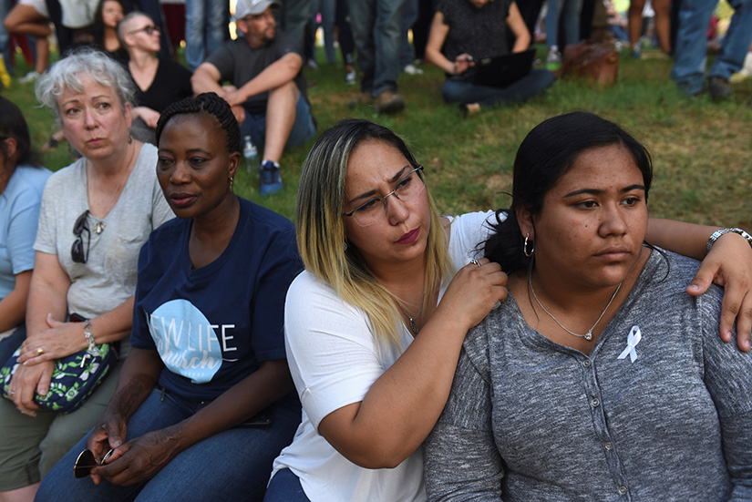 People gathered for a vigil Sept. 1 following a mass shooting Aug. 31 in Odessa, Texas. Seven people were killed and 25 were injured in a shooting along 10 miles of highways between Odessa and Midland, Texas.