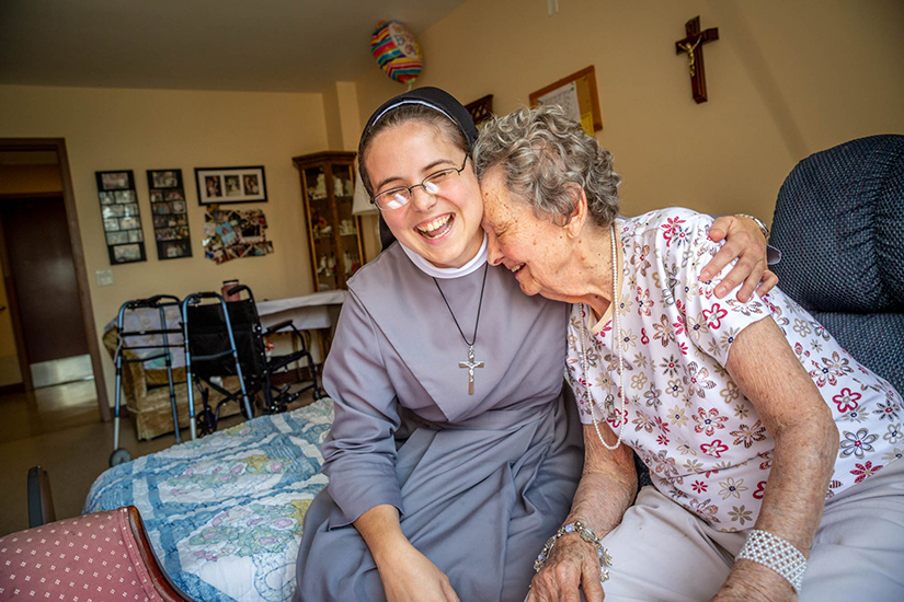Sister M. Stella Maris Larkin, FSGM, visited with Mary Jane Niemann, 94, at the Mother of Good Counsel Home on Sept. 12.