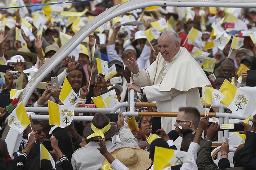 Pope Francis greeted the crowd before celebrating Mass at the Soamandrakizay diocesan field in Antananarivo, Madagascar, Sept. 8.