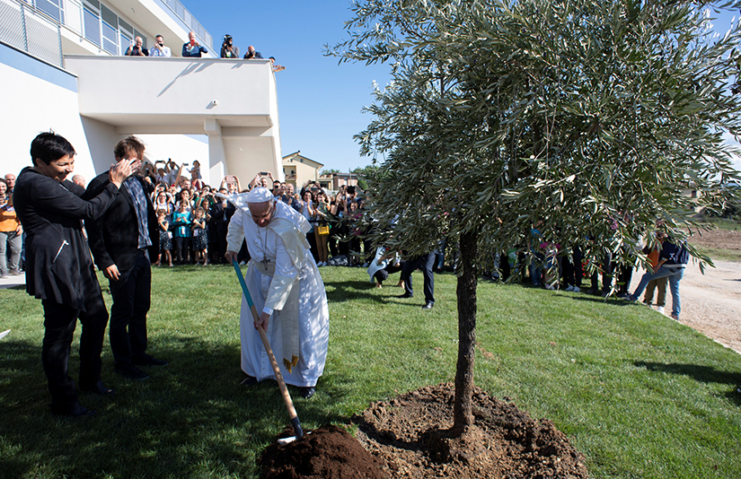 "Pope Francis turned over soil during a visit Sept. 24 to Cittadella Cielo (""Heaven's Citadel""), the headquarters of the New Horizons Community in Frosinone, Italy. The community is a lay movement that engages in evangelization and service to the disadvantaged, including young people dealing with addiction."