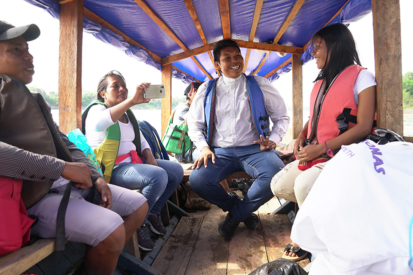Deacon Ferney Pereira and members of his Colombian parish took a boat on a river in the Amazon Sept. 8.