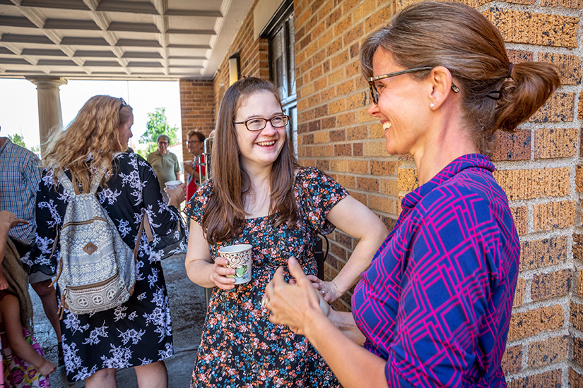 Bridget Perron talked with Elizabeth Wildman as parishioners gathered after Mass for fellowship and Breviary Coffee at Epiphany of Our Lord in St. Louis on Aug. 4. The parish provides coffee and a place for fellowship after 10:30 a.m. Mass on Sundays.